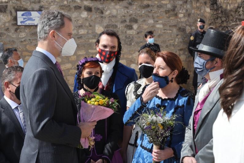 King Felipe of Spain is presented with flowers