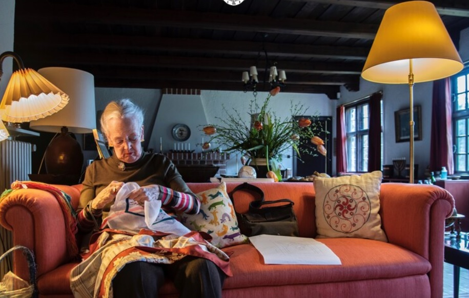 Queen Margrethe at work on her embroidery