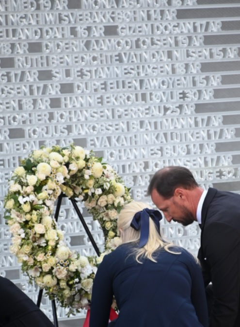 Norway's heir lays a wreath in memory of those killed in the Utoya terror attack on the tenth anniversary